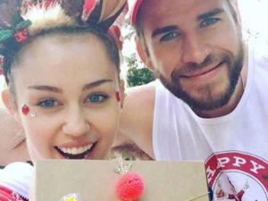 Liam Hemsworth e Miley Cyrus foto natale