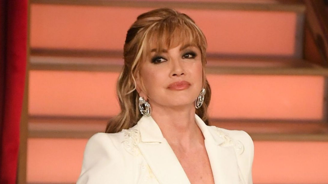 milly carlucci giacca bianca